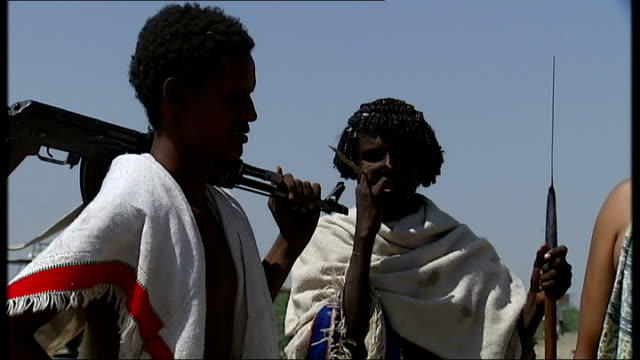 great rift valley / beisa oryx / baboons / nomad tribesmen; more of afar tribesmen stood chatting as looking at camera / more of traditional knife... - waist stock videos & royalty-free footage