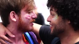 Affection Moment of Gay Couple in Gay Pride Parade