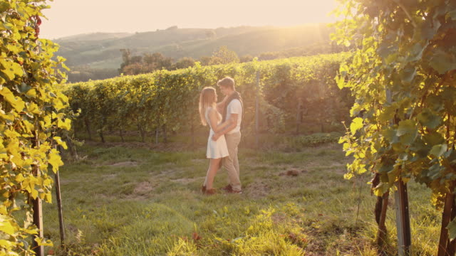 SLO MO Affectional couple in the vineyard