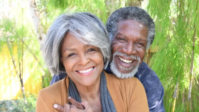 affectionate african american senior couple smiling looking to camera - 60 69 years stock videos & royalty-free footage