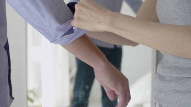 affectionate couple dressing - tie stock videos & royalty-free footage