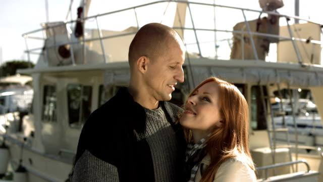 HD: Affectionate Couple On A Marina Dock
