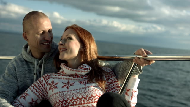 hd: affectionate couple on a sailing boat - mid adult couple stock videos and b-roll footage