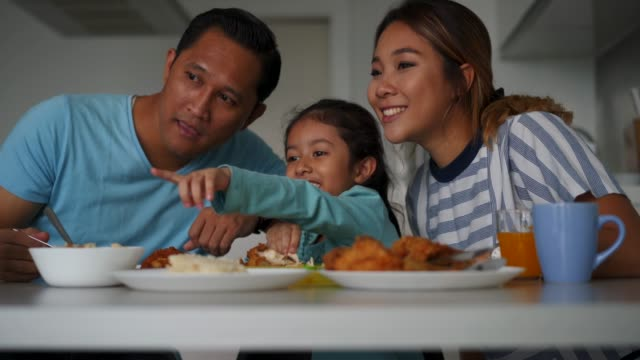 Affectionate family having lunch together at home