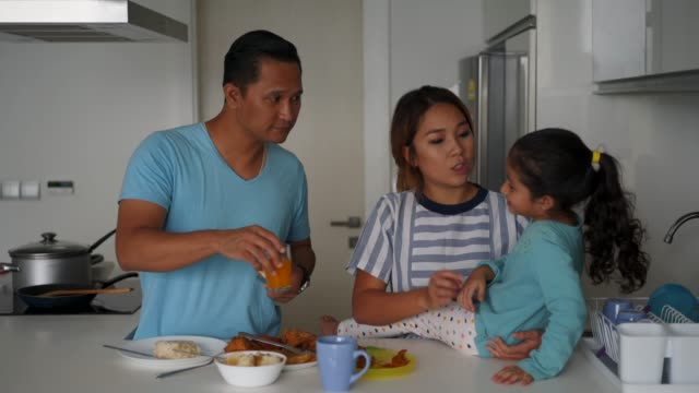 affectionate family preparing breakfast at home - malay family stock videos and b-roll footage