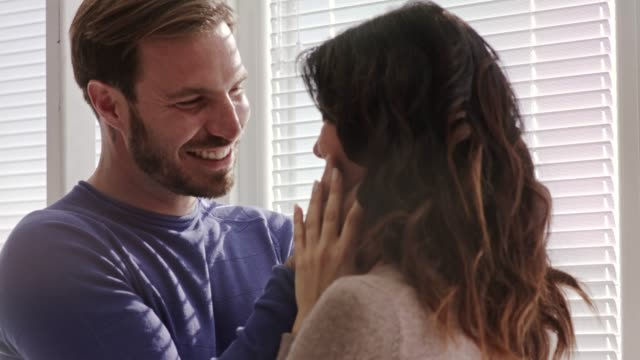 affectionate married couple standing in embrace, caressing and bonding - mid adult couple stock videos & royalty-free footage
