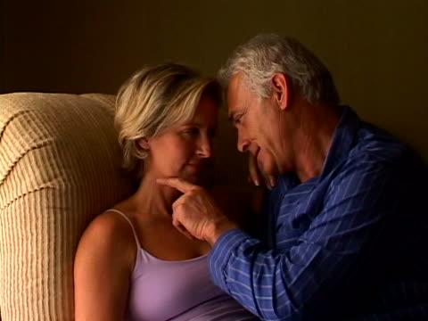 vídeos de stock e filmes b-roll de affectionate mature couple - carinhoso