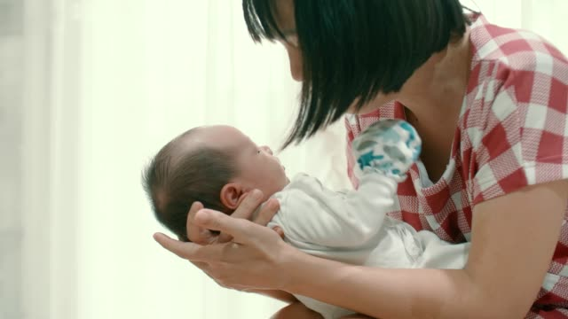 affectionate mother kissing her newborn son - 0 1 months stock videos & royalty-free footage