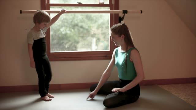 affectionate mother teaches son ballet at home studio - barre stock videos & royalty-free footage