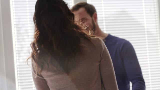vídeos y material grabado en eventos de stock de esposa afectuosa abrazando a su amoroso marido en su aniversario - pareja de mediana edad
