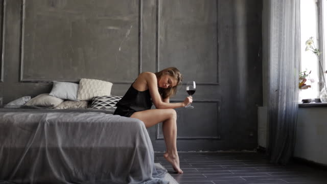 affectionate young girl drinking wine from big glass - elegance stock videos & royalty-free footage