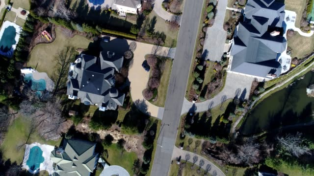 affluent neighborhood aerial camera view pointing down - stately home stock videos & royalty-free footage