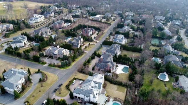 affluent neighborhood aerial flyover - new jersey stock videos & royalty-free footage