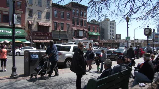 Affluent Neighborhood. People Relaxing, Talking / Hoboken, NJ - Springtime