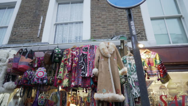 afgan coats hanging outside a shop on portobello road, london - notting hill videos stock videos & royalty-free footage