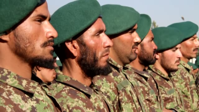 afghan army soldiers attend their graduation ceremony in kabul afghanistan on november 23 2014 a total of 1500 army soldiers graduated after three... - afghanische nationaltruppe stock-videos und b-roll-filmmaterial