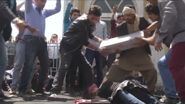 afghan artists play a role to depict the lynching of afghan woman farkhunda during a protest demanding justice for a woman who was beaten to death by... - afghanistan stock videos & royalty-free footage