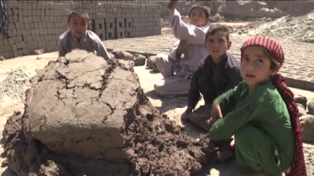 Afghan children work at a brick factory in Nangarhar Afghanistan on May 01 2016 Children work 12 to 18 hours a day and for 1000 bricks they get paid...
