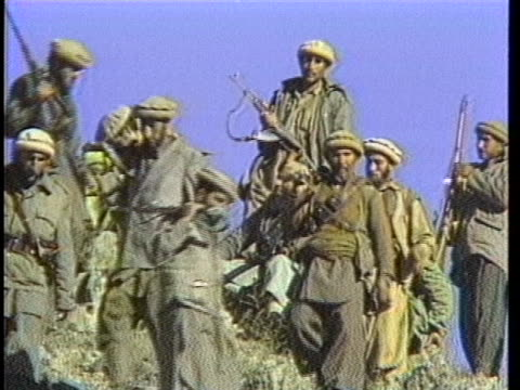 afghan citizens walk through the rubble of a bombed building during the soviet occupation of afghanistan. - former soviet union stock videos & royalty-free footage