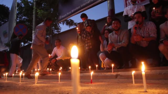 Afghan Civil society activists light candles during a memorial for the victims of a suicide bomb attack on Wednesday in Kabul Afghanistan on June 6...