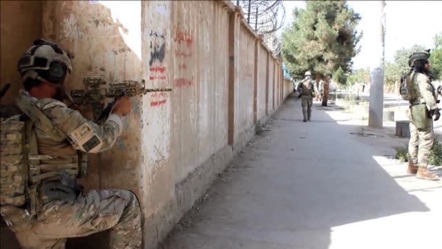 afghan forces conduct clearing operations in kunduz warning that taliban militants are hiding in civilian homes after an hours long assault on the... - taliban stock videos & royalty-free footage