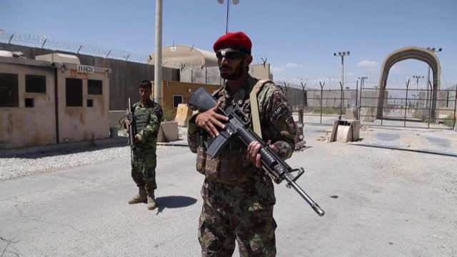 afghan forces guard one of the entrance gates to bagram after us and nato troops left the biggest air base in afghanistan, signalling the complete... - bagram stock videos & royalty-free footage
