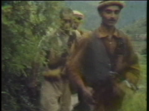 afghan guerrillas march along a rocky path during the soviet-afghan war. - afghanistan stock videos & royalty-free footage