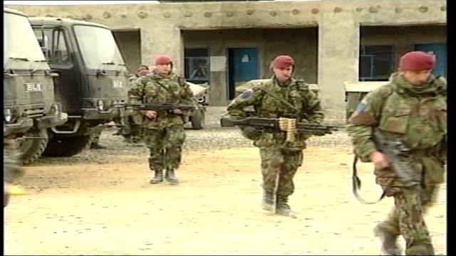 Afghan leader Hamid Karzai visits Britain LIB Armed British troops towards past as leaving barracks Paras into truck Trucks towards past