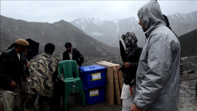 afghan men load donkeys with election materials in the rugged mountains of the panjshir valley on april 4 2014 - panjshir valley stock videos and b-roll footage