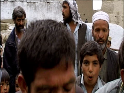 afghan men perform traditional song on eve of islamic new year (muharram) - muharram stock videos & royalty-free footage