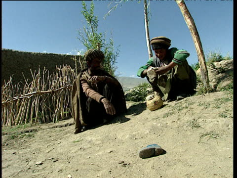 afghan men trade opium in barren landscape afghanistan - afghanistan stock videos & royalty-free footage