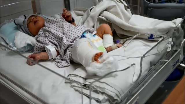 afghan newborns rescued and brought to various children hospitals are treated and fed by nurses after losing their mothers in a gunmen attack on a... - kabul stock videos & royalty-free footage