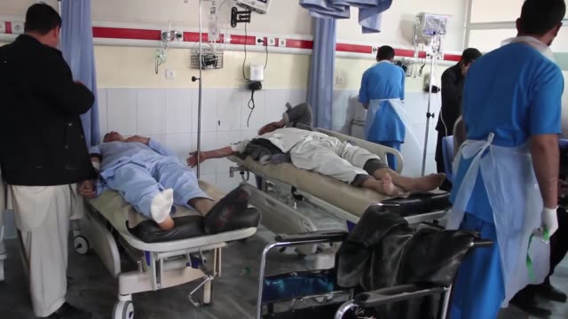 afghan people injured in an ambulance bomb blast receive treatment at a local hospital in kabul afghanistan on january 27 2018 a powerful suicide car... - kabul stock-videos und b-roll-filmmaterial