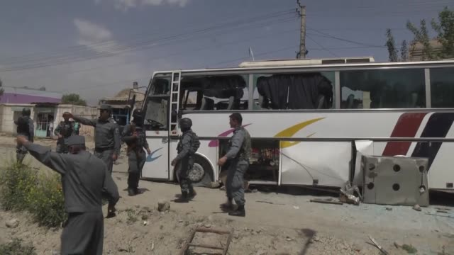 afghan police take security measures around the site where a suicide bomber on foot targeted a bus carrying staff from the attorney general office... - police chief stock videos and b-roll footage