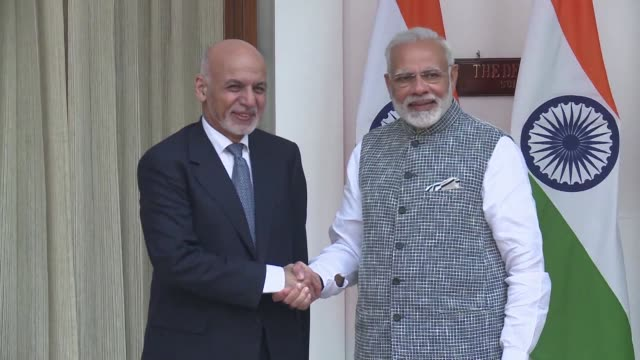 Afghan president Ashraf Ghani exchanges a handshake with Indian Prime Minister Narendra Modi during his visit to the Indian capital