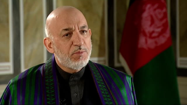 stockvideo's en b-roll-footage met afghan president hamid karzai interview england london int hamid karzai interview sot talks about friction with allies / on wanting military... - geallieerde mogendheden