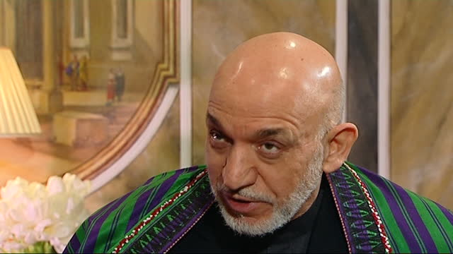 afghan president hamid karzai interview; part 2 of 10 england: london: claridge's: int hamid karzai interview sot. q: for years we heard that... - 10 11 years stock videos & royalty-free footage