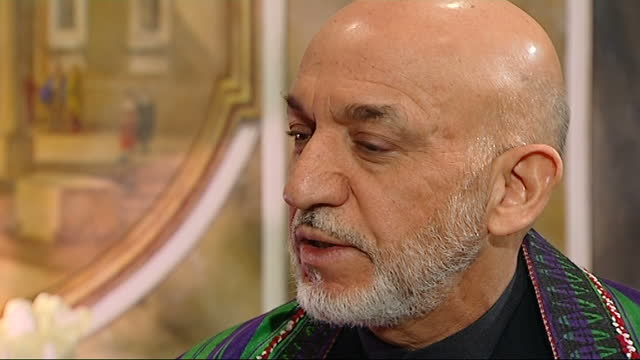 afghan president hamid karzai interview; part 4 of 10 england: london: claridge's: int hamid karzai interview sot. - of course kajaki dam is not a... - eyes closed stock videos & royalty-free footage