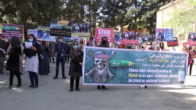 afghan protesters shout slogans and hold placards during a demonstration against the testing of mother of all bombs by us on april 16 2017 in kabul... - moab utah stock-videos und b-roll-filmmaterial