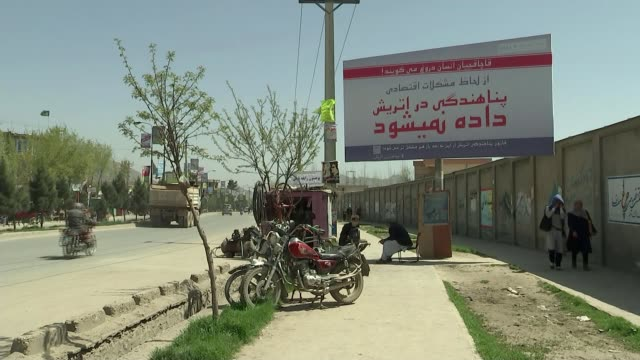 Afghan refugees faced with repatriation as Taliban announces 'Spring offensive' AFGHANISTAN Kabul Large advertising hoarding in city centre street...