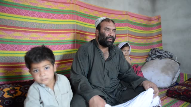 afghan refugees fled from civil war in afghanistan live in harsh conditions at a refugee camp in a slum of islamabad pakistan on june 19 2017 - 2017 stock-videos und b-roll-filmmaterial