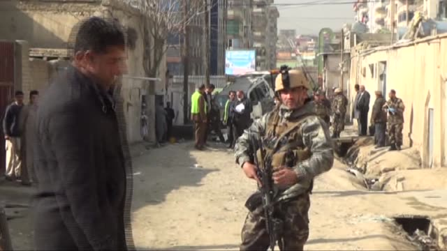 afghan security forces inspect the scene of a suicide bomb attack which targeted the regional director at the independent election commission, awal... - suicide bombing stock videos & royalty-free footage