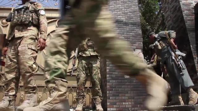 Afghan security forces stand at the site of a suicide attack on MP Zahir Qadir's house in Jalalabad Afghanistan on August 30 2017 An Afghan official...
