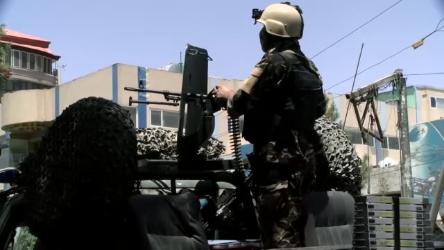 Afghan security officials gather at the site of an attack targeting the Iraqi embassy in Kabul Afghanistan on July 31 2017 The Iraqi Embassy in the...