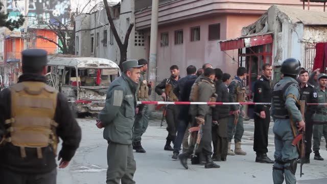 Afghan security officials inspect the explosion site that targeted employee's buss in Kabul Afghanistan on March 13 2017 A powerful explosion has...