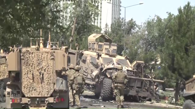 afghan security officials inspect the site of a suicide bomb blast that targeted the convoy of foreign troops in kabul, afghanistan, on june 30,... - suicide bombing stock videos & royalty-free footage