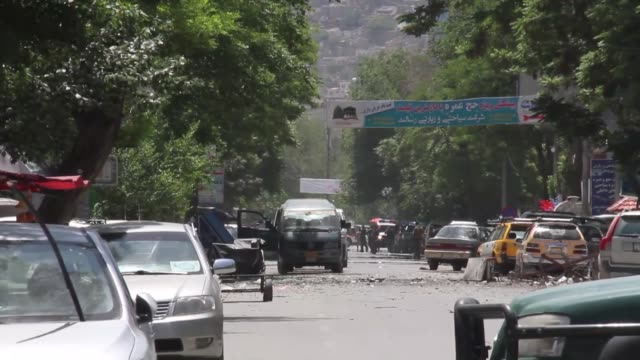 afghan security personnel inspect the site of an attack in central kabul, afghanistan, on may 2018. multiple blasts and gunfire on wednesday rocked... - kabul stock videos & royalty-free footage
