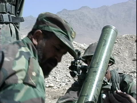 afghan soldier looking through viewfinder of rocket launcher during military training / afghanistan - rocket launcher stock videos & royalty-free footage