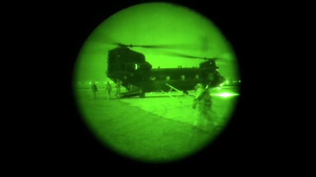 afghan special security forces and us special operators killed an isisk commander and another terrorist fighter during a partnered nighttime raid in... - night vision stock videos and b-roll footage