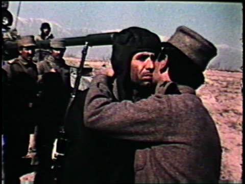 afghan tank command being presented party membership cards in field banner of the april revolution on january 01 1980 in afghanistan - civil war stock videos & royalty-free footage